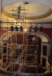 Scaffolding extends to the full 40-foot height of the ceiling in the opera house in order to make repairs.