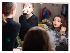 Kids putting on makeup